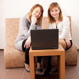 Happy young females with laptop Stock Photo