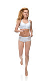 Happy young fitness beautiful slim sport woman jogging and runni Royalty Free Stock Image