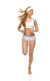 Happy young fitness beautiful slim sport woman jogging and runni Stock Photo