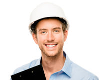 Happy young foreman on building site with hard hat white backgro. Happy young foreman on building site with hard hat Royalty Free Stock Images