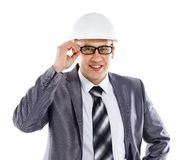 Happy young foreman on building site with hard hat. White background Royalty Free Stock Images