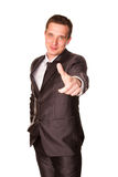 Happy young friendly smiling businessman pointing finger Stock Images