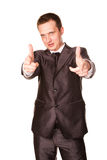 Happy young friendly smiling businessman pointing finger Stock Photography