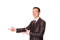 Happy young friendly smiling businessman pointing finger Royalty Free Stock Photo