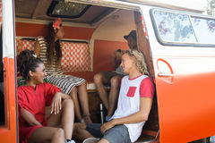Happy young friends in camper van Royalty Free Stock Photos