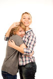 Happy young friends giving each other a hug Stock Image