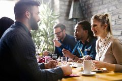 Happy young friends hangout in coffee shop royalty free stock photos