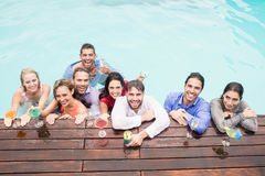 Happy young friends having drinks Stock Photo