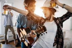 Happy young friends having fun and partying to music. Happy group of young friends having fun and partying to music Stock Images
