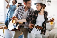 Happy young friends having fun and partying to music. Happy group of young friends having fun and partying to music Stock Photography