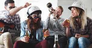 Happy young friends having fun and partying to music. Happy group of young friends having fun and partying to music Royalty Free Stock Images