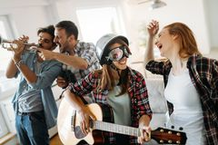 Happy young friends having fun and partying to music. Happy group of young friends having fun and partying to music Royalty Free Stock Photos