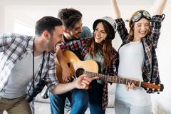 Happy young friends having fun and partying to music. Happy group of young friends having fun and partying to music Royalty Free Stock Image