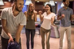 Friends playing bowling Stock Photo