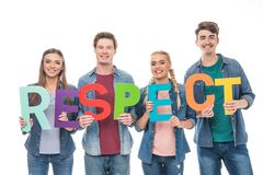 Friends holding word respect. Happy young friends holding colorful word respect  on white Stock Image