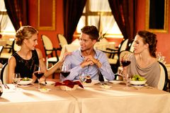 Happy young friends  in luxury restaurant Stock Photography