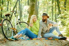Happy young friends in park on sunny autumn day. Enjoying good weather. Happy young friends in park on sunny autumn day. Enjoying good weather royalty free stock image