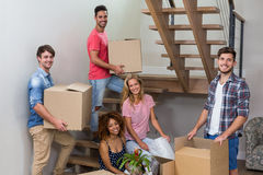 Happy young friends relocating in new house Stock Images