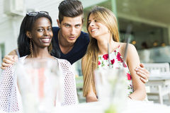 Happy young friends smiling outdoors being close to each other Stock Photography