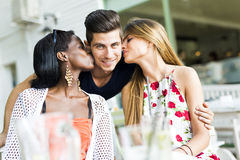 Happy young friends smiling outdoors being close to each other. On a summer day Stock Photo