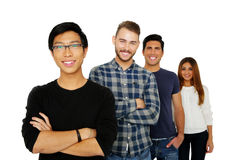 Happy young friends standing in a row Royalty Free Stock Photos