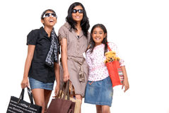 Happy young friends standing with shopping bags Royalty Free Stock Photo