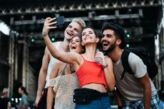 Happy friends taking selfie at music festival Royalty Free Stock Photos
