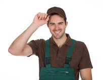 Happy young gardener in dungarees Royalty Free Stock Image