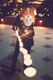 Young ginger woman holding fairy lights and smile outdoors royalty free stock photos