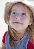 Happy young girl. With a serene expression, in beach hat Stock Images