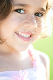 Happy young girl. Portrait of happy young girl with green background Royalty Free Stock Images