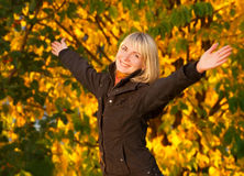 Happy young girl. Over autumn background Stock Images
