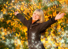 Happy young girl. Over abstract autumn background Stock Photo