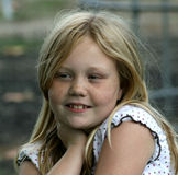 Happy young girl. Portrait of happy young girl with blond hair outdoors Royalty Free Stock Images