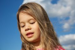 Happy Young Girl against Cloudy Sky Royalty Free Stock Photo