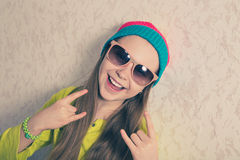 Happy young girl against the wall. Royalty Free Stock Photos