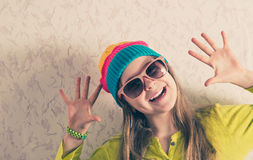 Happy young girl against the wall. Royalty Free Stock Photography