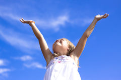 Happy young girl, arms raised Royalty Free Stock Photos