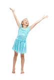 Happy Young Girl with Arms Up. Happy Young Girl in Blue Dress with Arms in the Air - Isolated on White Stock Photography