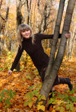 Happy young girl on autumn background Stock Photography