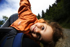 Happy young girl in a baby carrier Stock Photography
