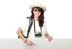 Happy young girl with backpack showing blank board Stock Photography