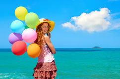 Happy young girl on the beach Stock Images