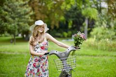 Happy young girl with bicycle Stock Photos