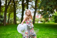 Happy young girl with bicycle Royalty Free Stock Image