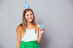 Happy young girl in birthday hat and whistle Stock Photography
