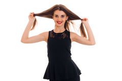Happy young girl in black dress looking and smiling on camera isolated  white background in studio Stock Photo