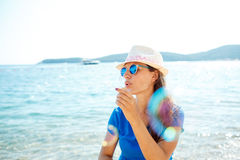 Happy young girl blowing soap bubbles on the seashore Royalty Free Stock Image
