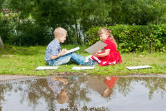 Happy Young  girl  and  boy Writing  .Smiling in Stock Image