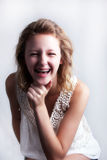 Happy young girl with braces. Braces don't have to make you sad; happy and pretty young girl is laughing and wearing braces Royalty Free Stock Images
